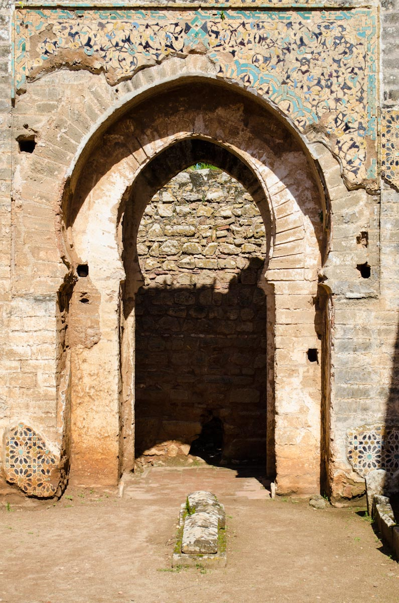 Old doorway with remnants of tiling at Chella