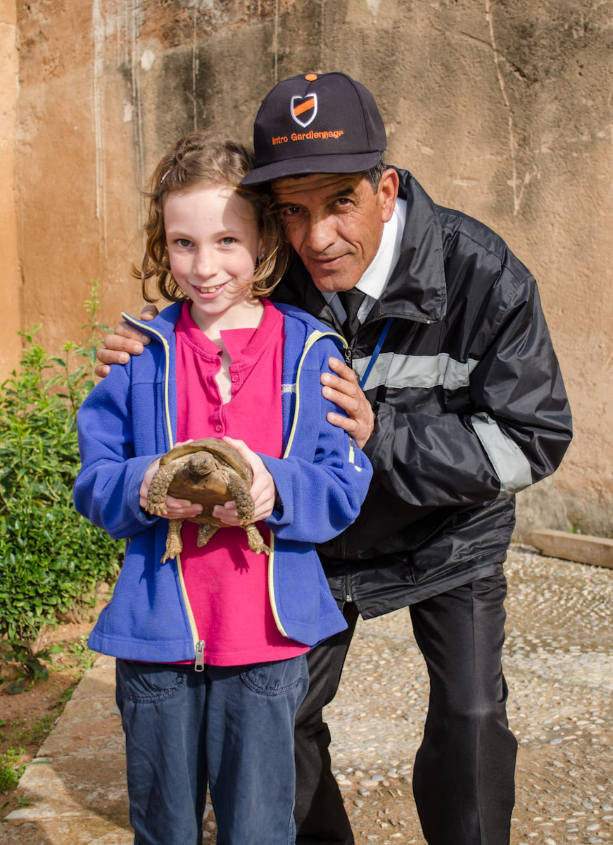 Mohammad and Sydney with a tortoise