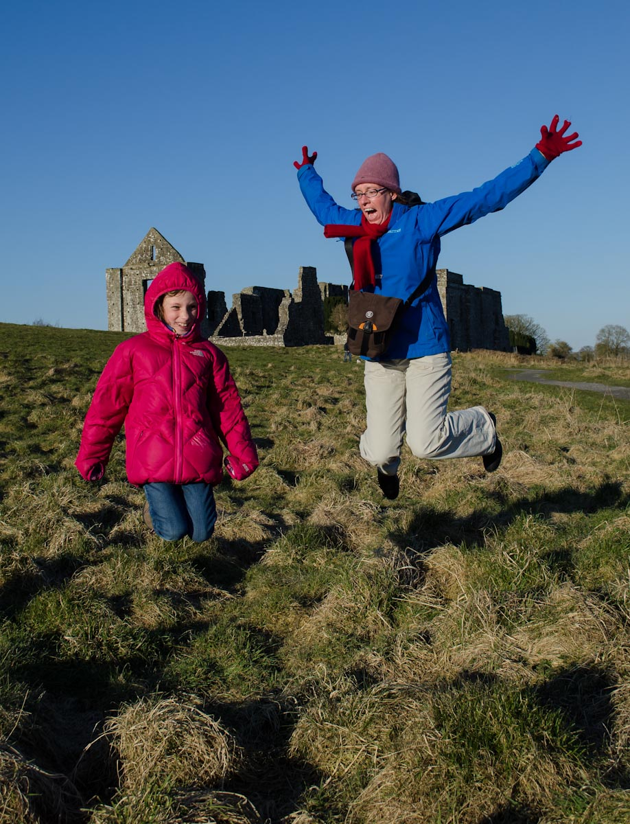 Sydney and Kerri jumping in front of Newtown Abbey