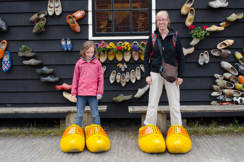 Trying on giant wooden shoes
