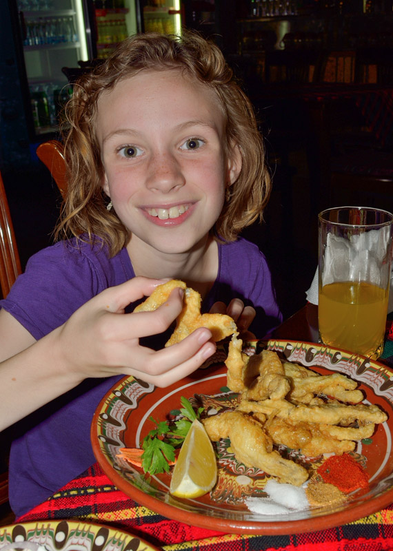 Sydney trying frog legs for the first time