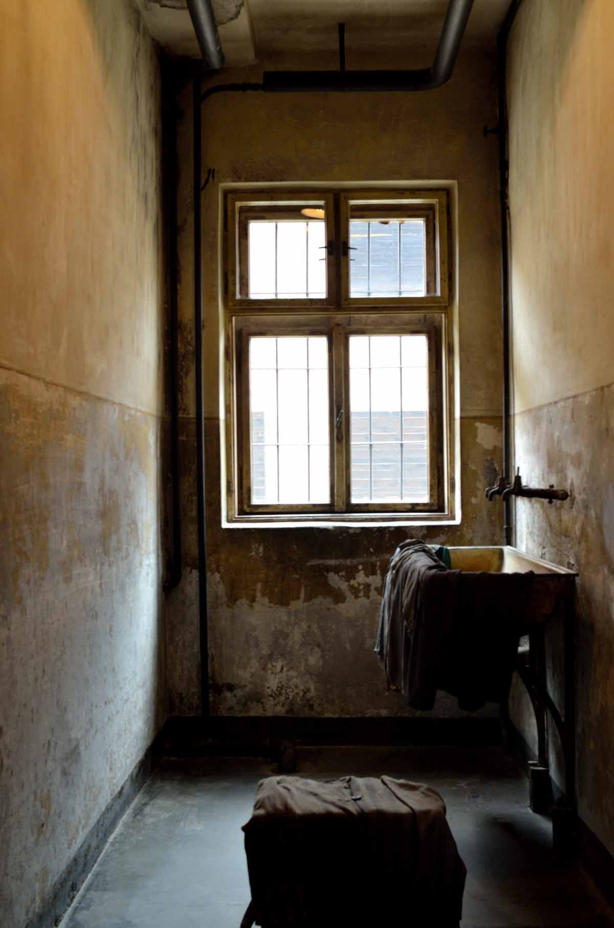 Clothes on sink in cell