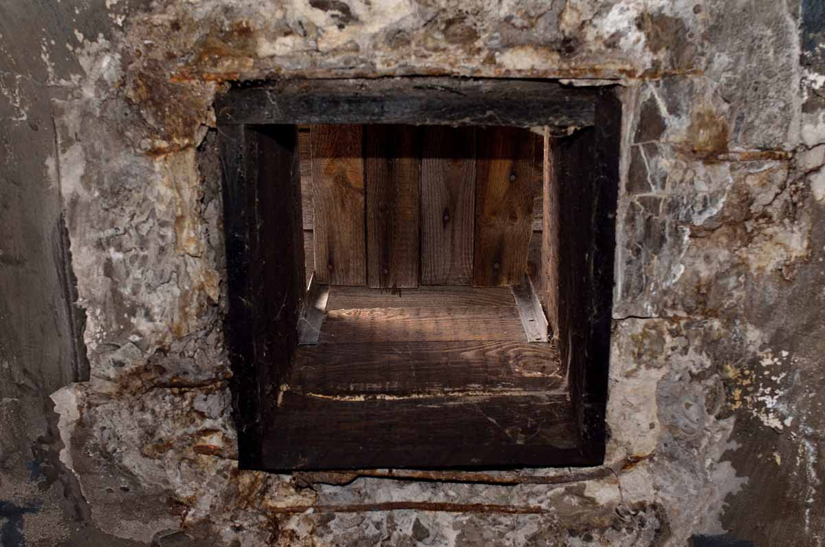 Hole in the ceiling of the gas chamber used to drop in gas canister