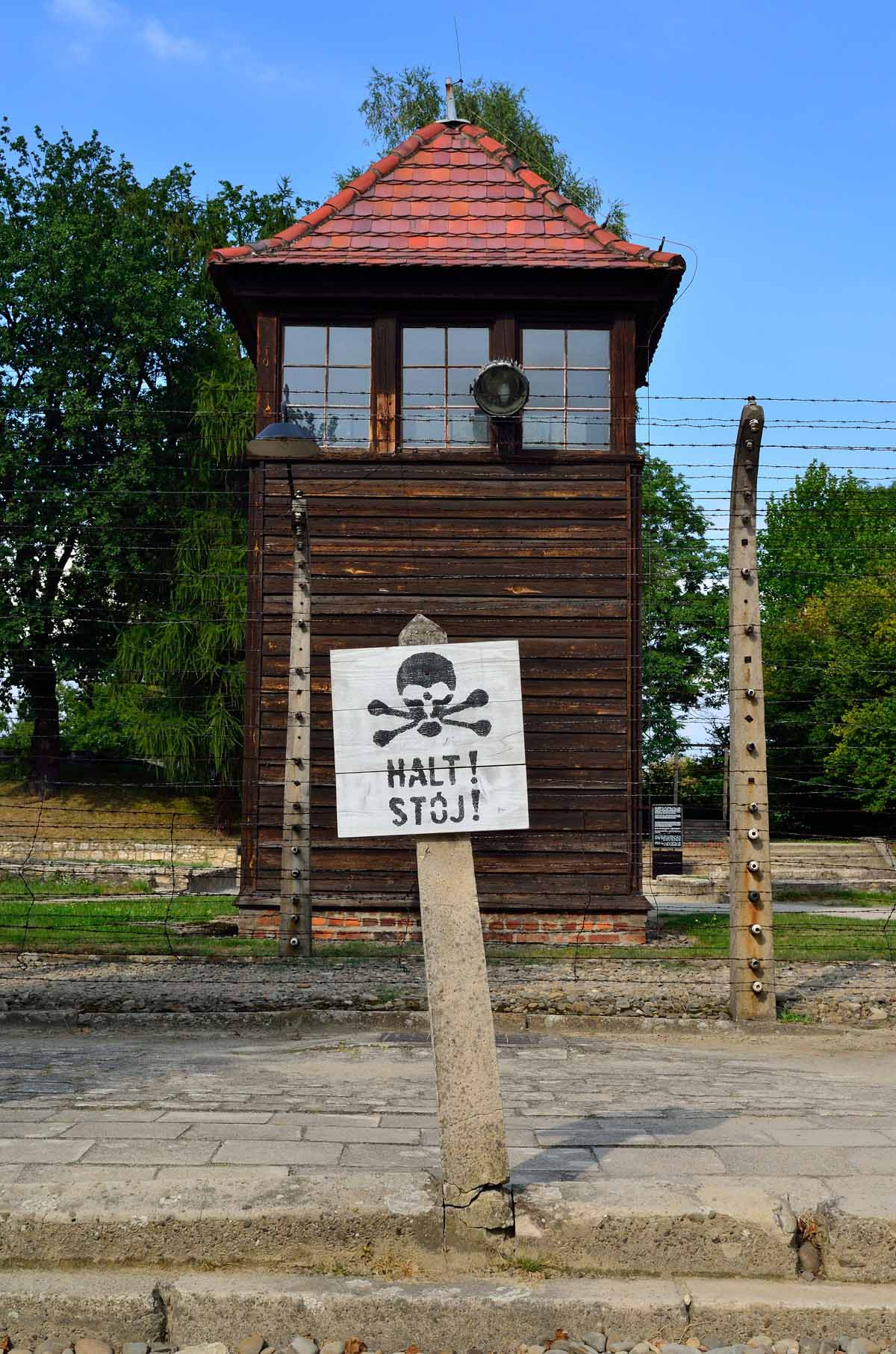 photo essay auschwitz and birkenau warning sign