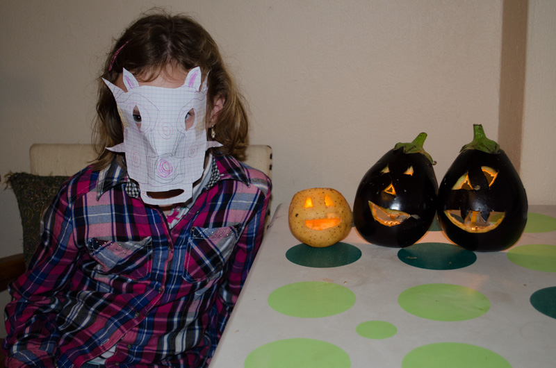 Sydney and her scary Halloween mask with the Jack-O-Lanterns