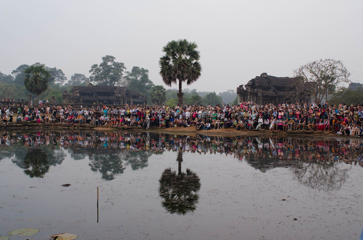 Crowds of people gathered for the sunrise at Angkor Wat