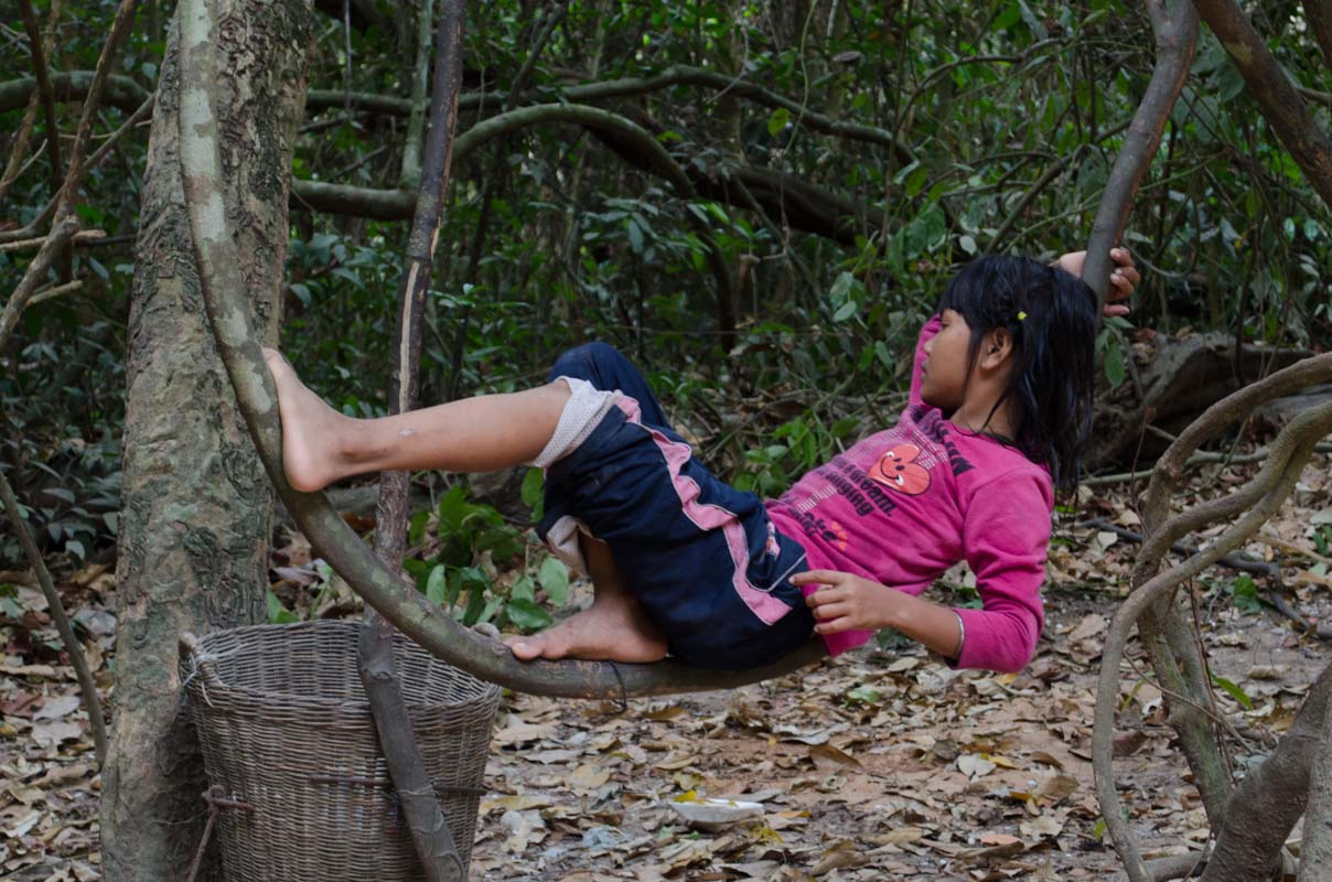 Girl relaxing on tree