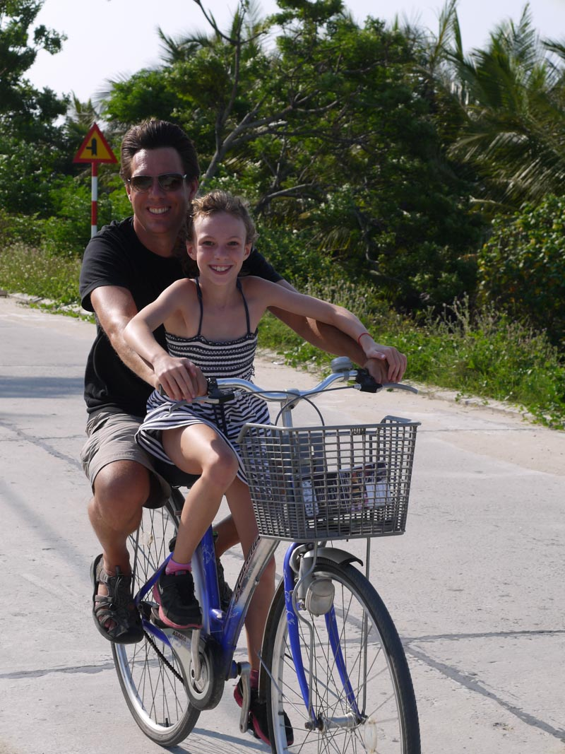 Riding bikes along the palm groves